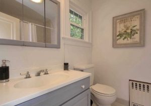 Simple touches such as painting this bath room vanity a subtle gray can make a big difference - Timeless Decor - Interior Design & Home Staging, Ridgewood, NJ 07450