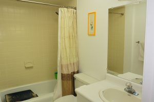 Reglazing dated tile can transform a bathroom.